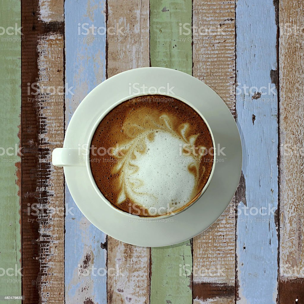 bird eye view of coffee cup on old table stock photo