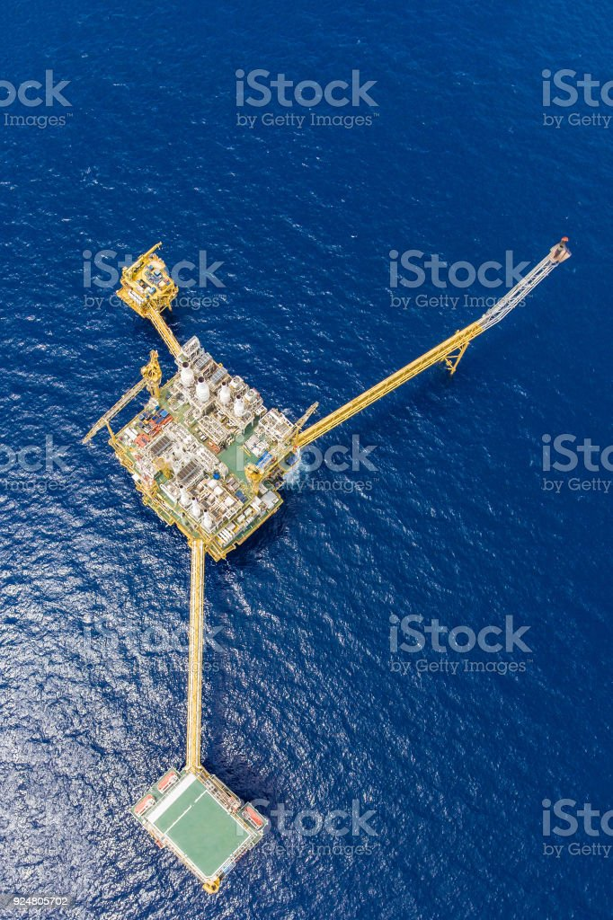 Bird eye view of offshore oil and gas central processing platform which comprised of central facility, accommodation area, flare and remote platform, power and energy business. stock photo