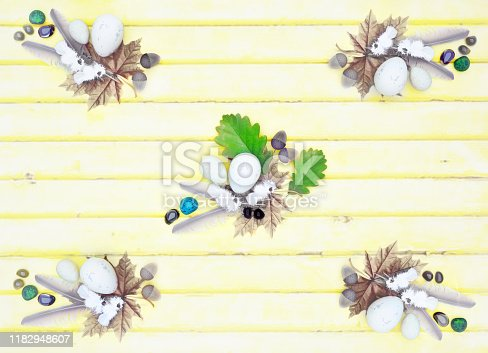 istock Bird feathers, stones, eggs, oak leaves, acorns, maple leaves on light wooden background on top view. 3D render 1182948607
