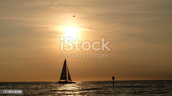 Clearwater Beach, Florida. A catamaran is sailing during one of the classic beautiful sunsets.