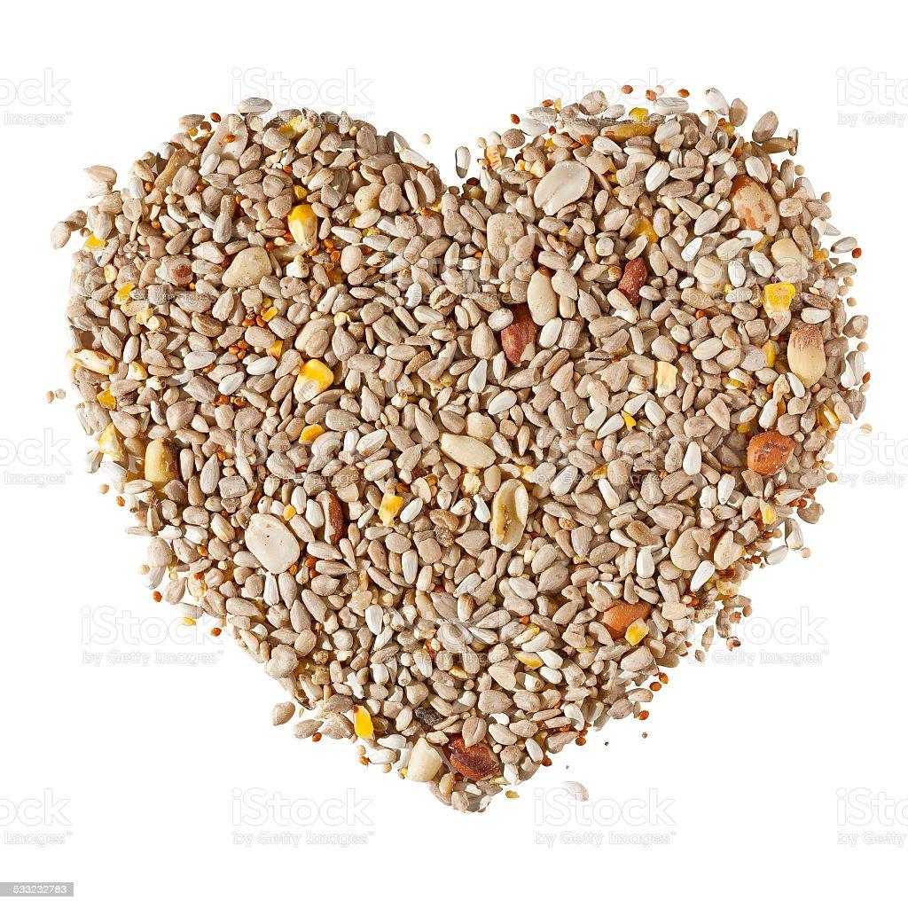 Bird Seed Heart on White Background stock photo