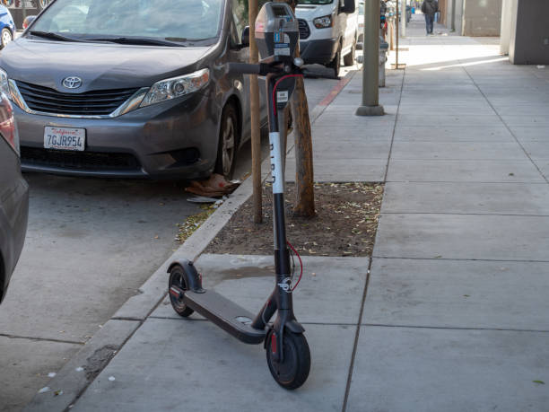 Bird, transportation start up, electric scouter parked on sidewalk stock photo