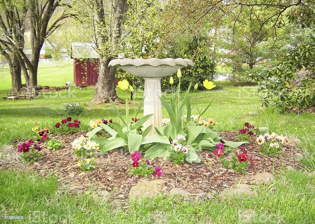 Birdbath Surrounded by Flowers royalty-free stock photo