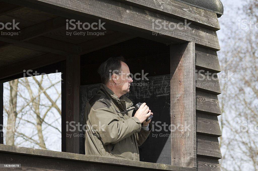 birder with binoculars royalty-free stock photo