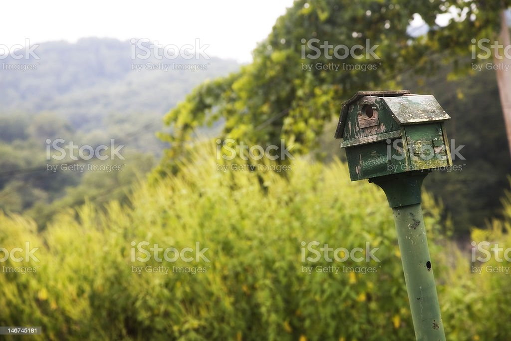 Birdhouse in nature royalty-free stock photo