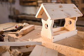 Close-up of birdhouse on table in workshop.