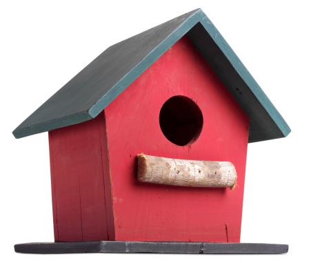 A birdhouse on white