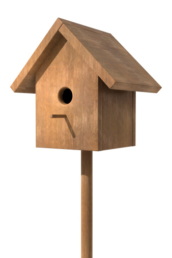 Wooden bird house on a pole with a white background.Could be a useful element in a composition.This is a detailed 3d rendering.