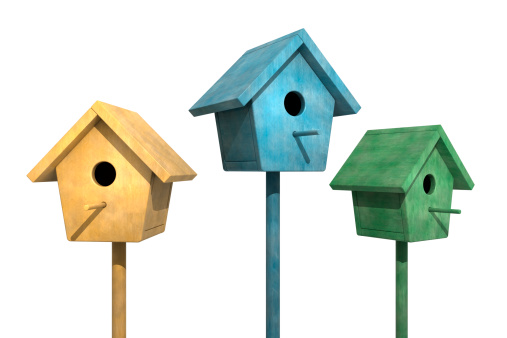 Colorful weathered Birdhouses in a row on a white background.Could be useful in a spring or bird composition.This is a detailed 3d rendering.