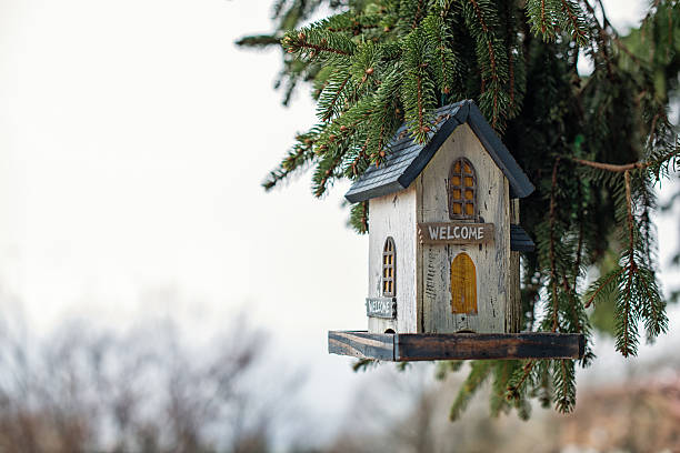birdhouse with welcome sign stock photo