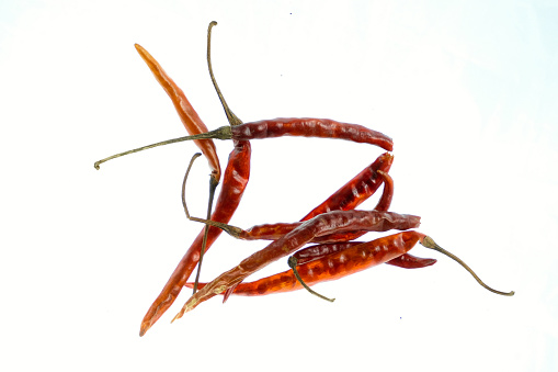 Bird's beak chiles and rat's tail chiles, chile de árbol, isolated on a withe background