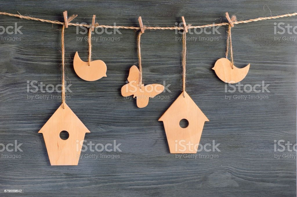 birds, birdhouses, butterflies on a rope stock photo