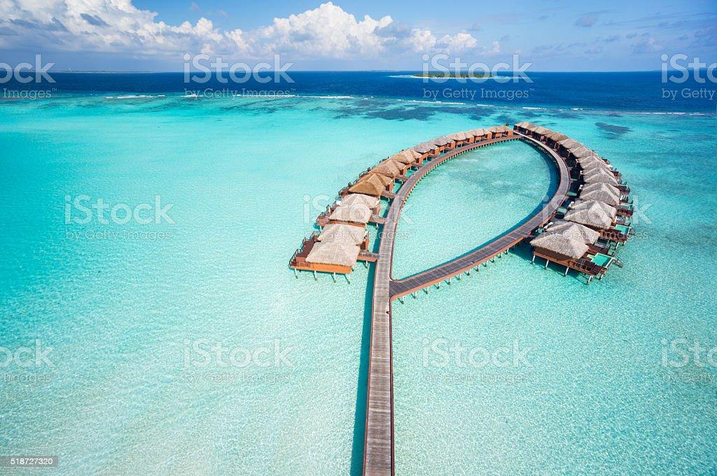 bird's eye view luxury overwater villas stock photo