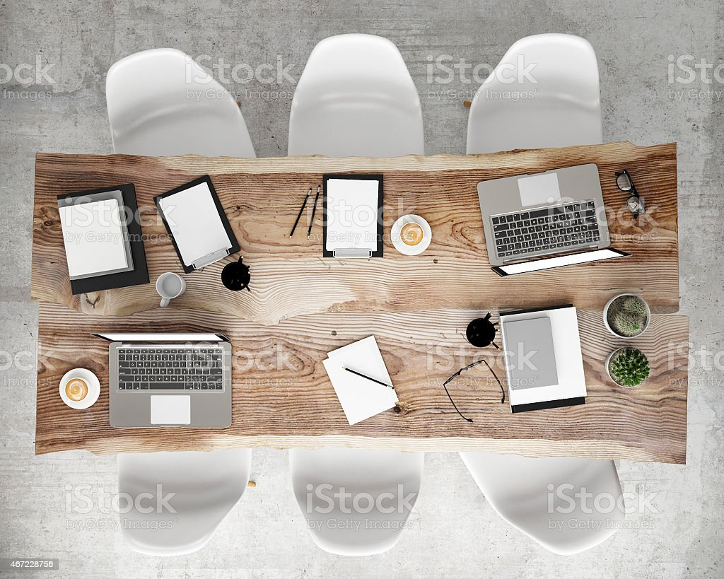 Birds eye view of a conference table, complete with laptops stock photo