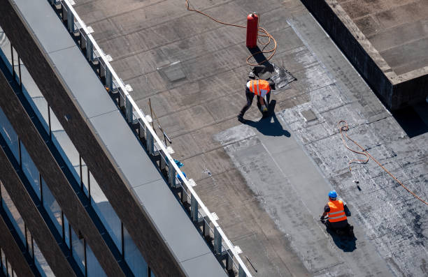 Birds eye view of a roof construction site. Professional bitumen waterproofing on a flat building. stock photo