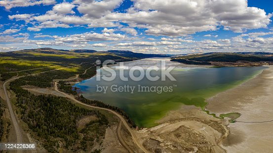 Elevated perspective view of a large tailings storage pond alongside the Highland Valley Road between Ashcroft and Logan Lake from the Highland Valley Copper Mine in British Columbia, Canada