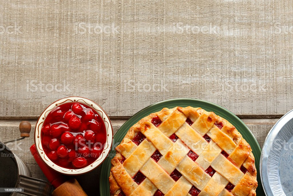 Bird's Eye view of classic cherry pie on picnic table stock photo