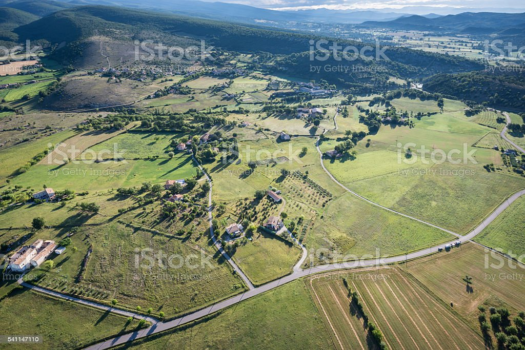 Birds eye view of cultivated land, roads and private houses stock photo