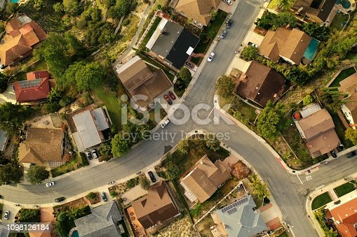 Top down view of Los Angeles Suburb, La Canada, looking down at rooftops, pools, backyards, streets and neighborhoods.