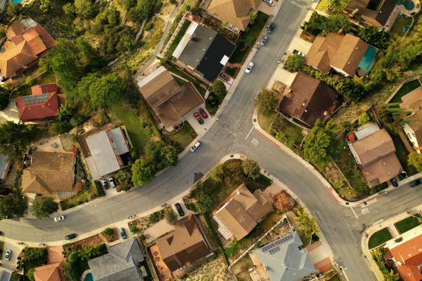 Birds Eye View of Southern California Suburban Sprawl - Drone Photo Top down view of Los Angeles Suburb, La Canada, looking down at rooftops, pools, backyards, streets and neighborhoods. drone point of view stock pictures, royalty-free photos & images