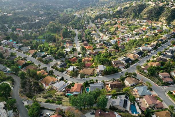 Birds Eye View of Southern California Suburban Sprawl - Drone Photo Top down view of Los Angeles Suburb, La Canada, looking down at rooftops, pools, backyards, streets and neighborhoods. urban sprawl stock pictures, royalty-free photos & images