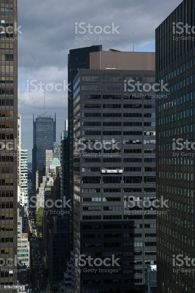 Bird's eye view of the Manhattan, New York City 40th Street urban canyon on a partly cloudy day. stock photo