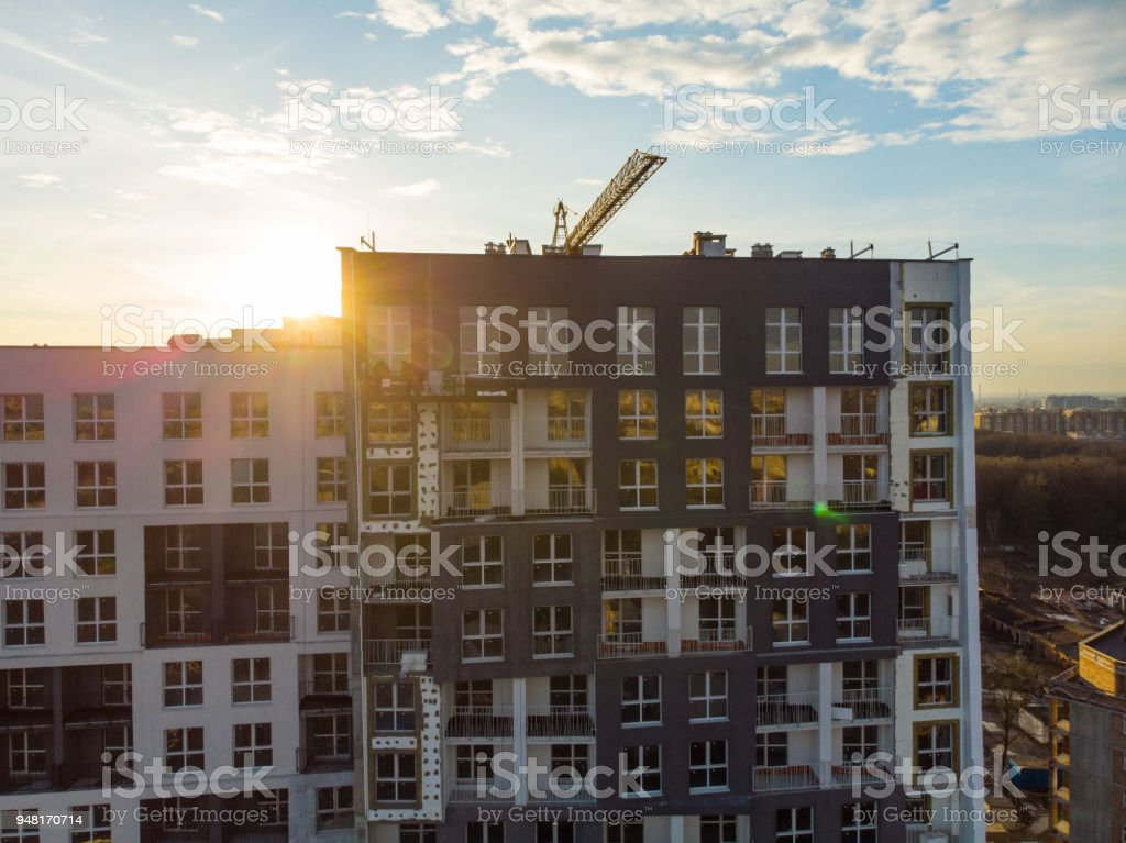 birds eye view on contraction site with crane on sunset stock photo
