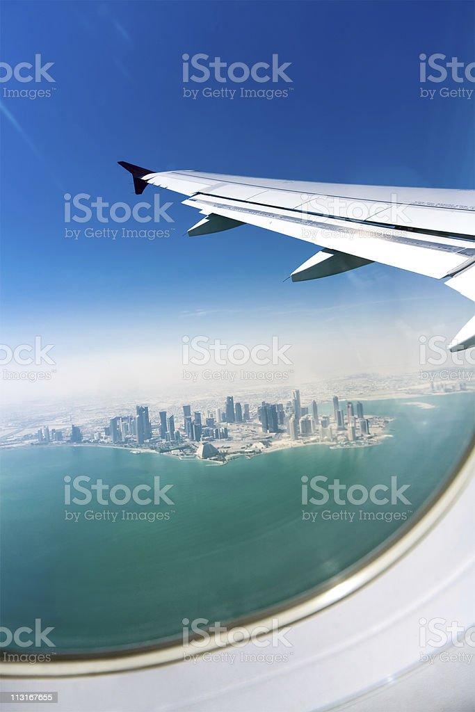 Bird's eye view on modern city under the plane wing stock photo