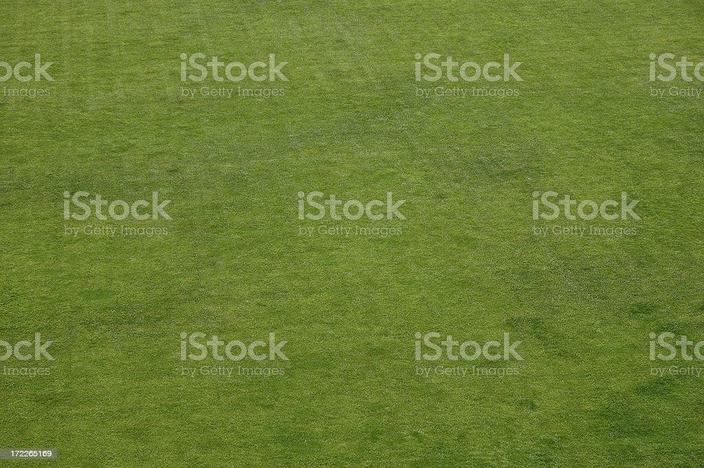 Birdseye view of grass field mowed in a crossing pattern stock photo