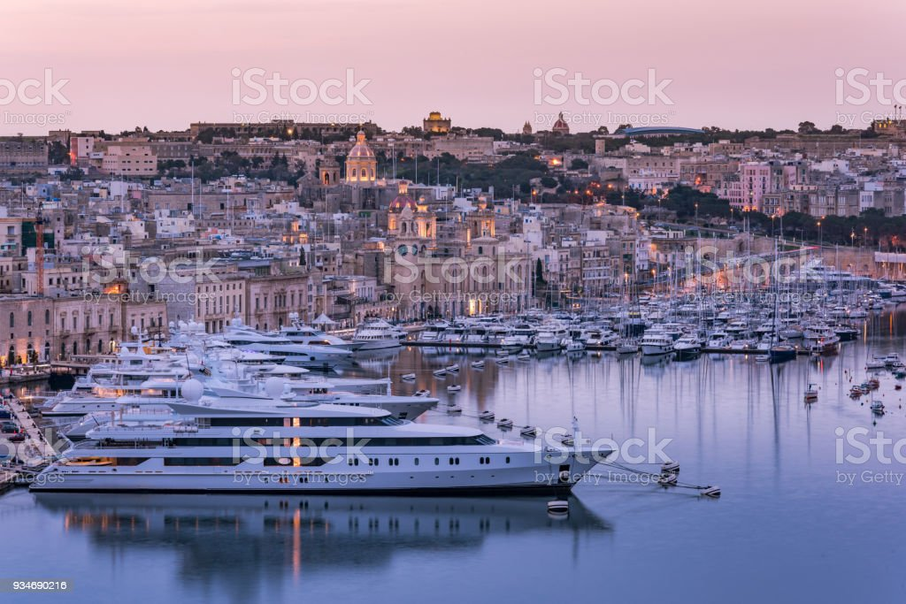 Birgu at evening and luxury yachts in harbor,Malta stock photo