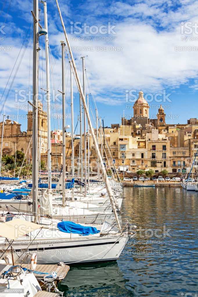 Birgu waterfront marina in front of Our Lady of Annunciation Church, St. Dominic's Church stock photo