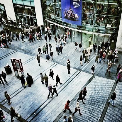 Birmingham,UK - December 1, 2012: Christmas shoppers viewed from above outside Birmingham's Bullring Shopping Centre, Birmingham, UK.