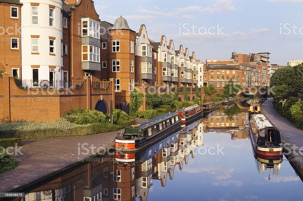 Birmingham Canal Main Line with Narrow Boats and Modern Apartments royalty-free stock photo