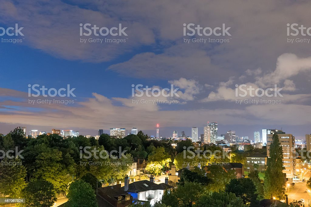 Birmingham City at night with some light in the sky. stock photo