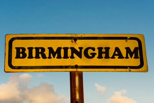 Birmingham city street old antique yellow sign with blue sky at background, USA signal city series. stock photo
