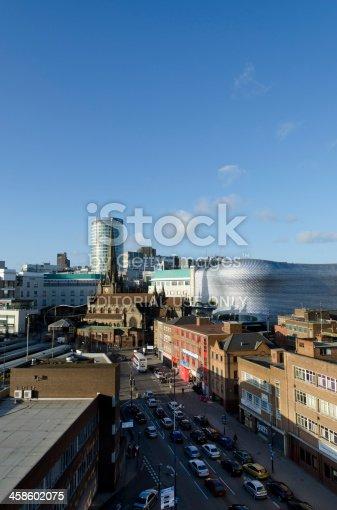 Birmingham, United Kingdom - November 27, 2011: Birmingham skyline. Elevated view up Moat Lane towards St Martin's Church and the Bullring shopping centre. The Birmingham skyline is a jumble of contrasting architectural styles, Victorian, 60's and early 21st Century redevelopment. The Bullring shopping district was re-developed in early 2000, the futuristic Selfridges department store on the right was designed by Future Systems architecture practice and has won many awards.