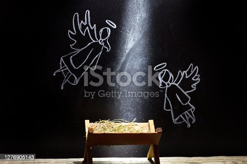 Birth of Jesus, manger and angels on blackboard abstract christmas nativity scene art