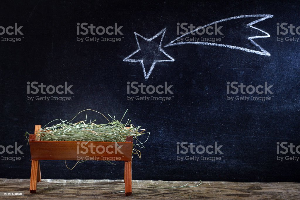 Birth of Jesus with manger and star on blackboard abstract christmas...
