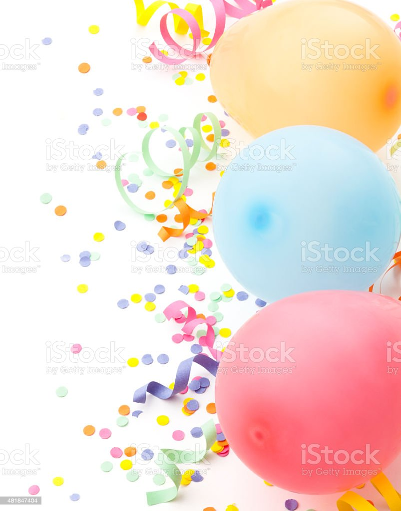 Birthday arrangement. Balloons and confetti isolated on white. stock photo