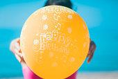 Birthday balloon on the beach