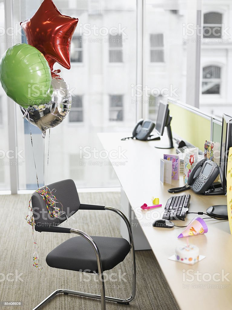 Birthday balloons tied to office chair royalty-free stock photo