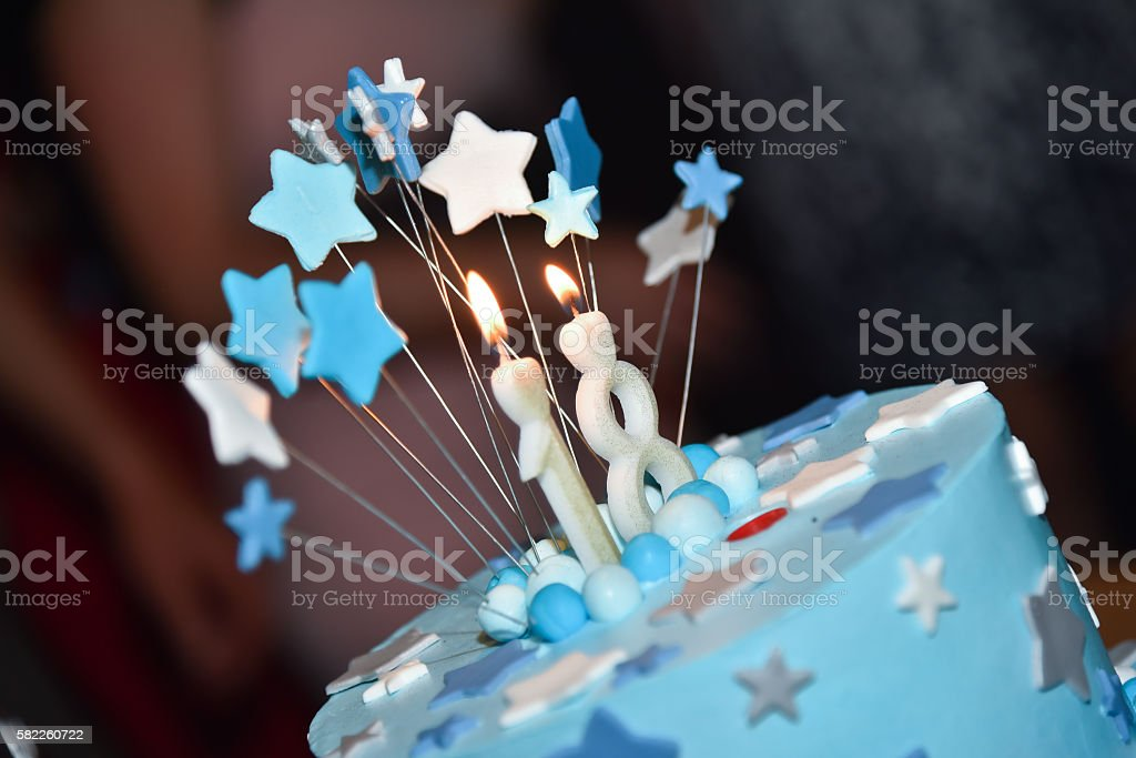 Birthday blue Cake with Candle stock photo