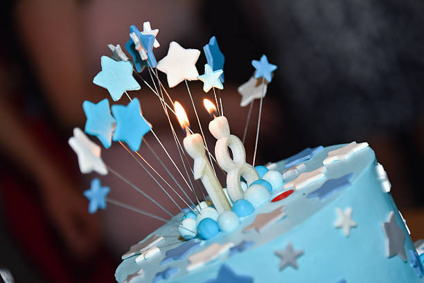 birthday blue cake with candle - number 18 stock photos and pictures