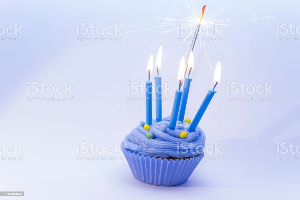 Astonishing Birthday Blue Cupcake With Candles And Sparklers Stock Photo Funny Birthday Cards Online Alyptdamsfinfo