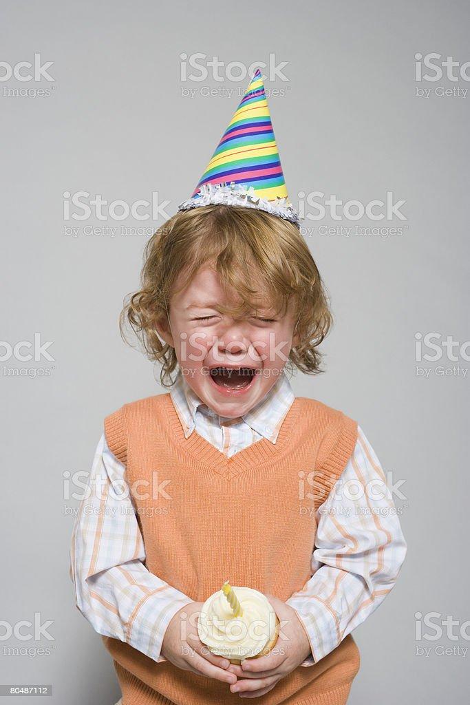 Birthday boy having a tantrum stock photo