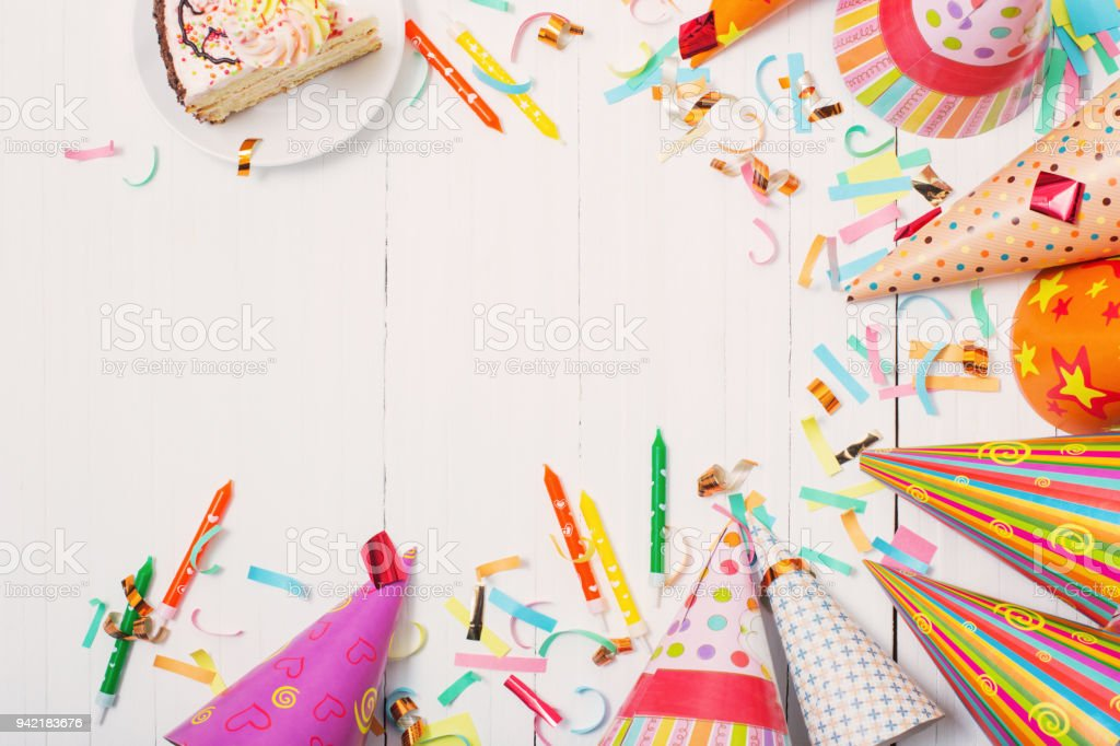 birthday cake and decoration on white wooden background