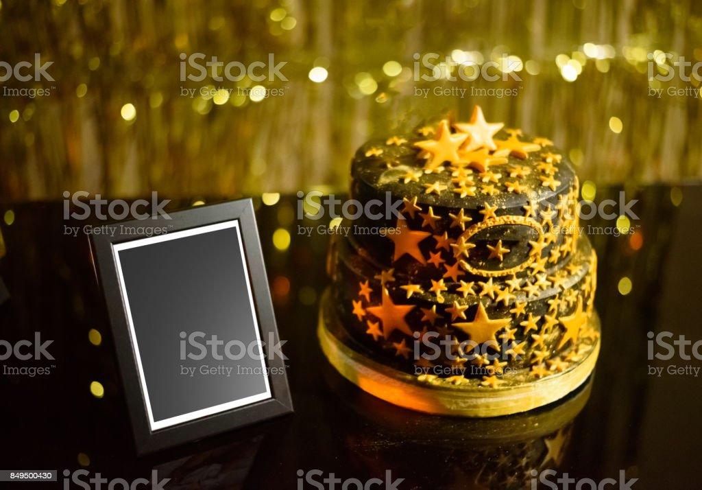Birthday Cake and Empty Frame stock photo
