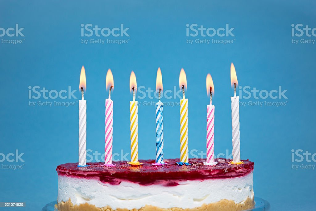 Birthday cake and flaming candles stock photo