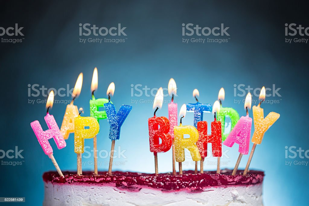 Birthday Cake and shaped candles stock photo