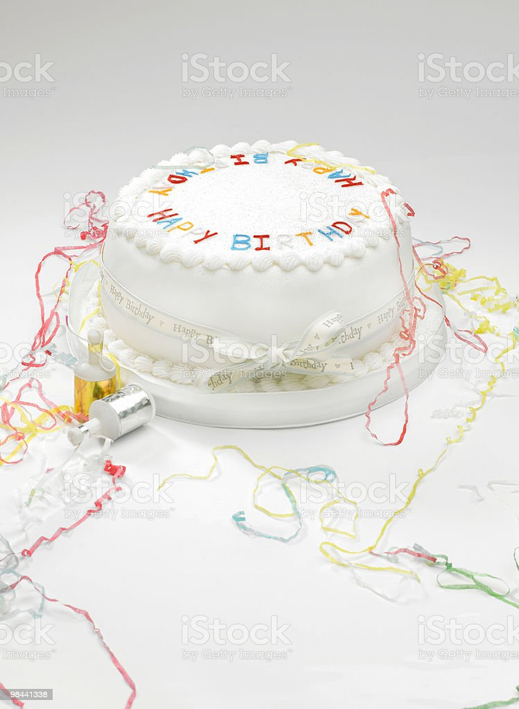 Birthday cake and streamers royalty-free stock photo